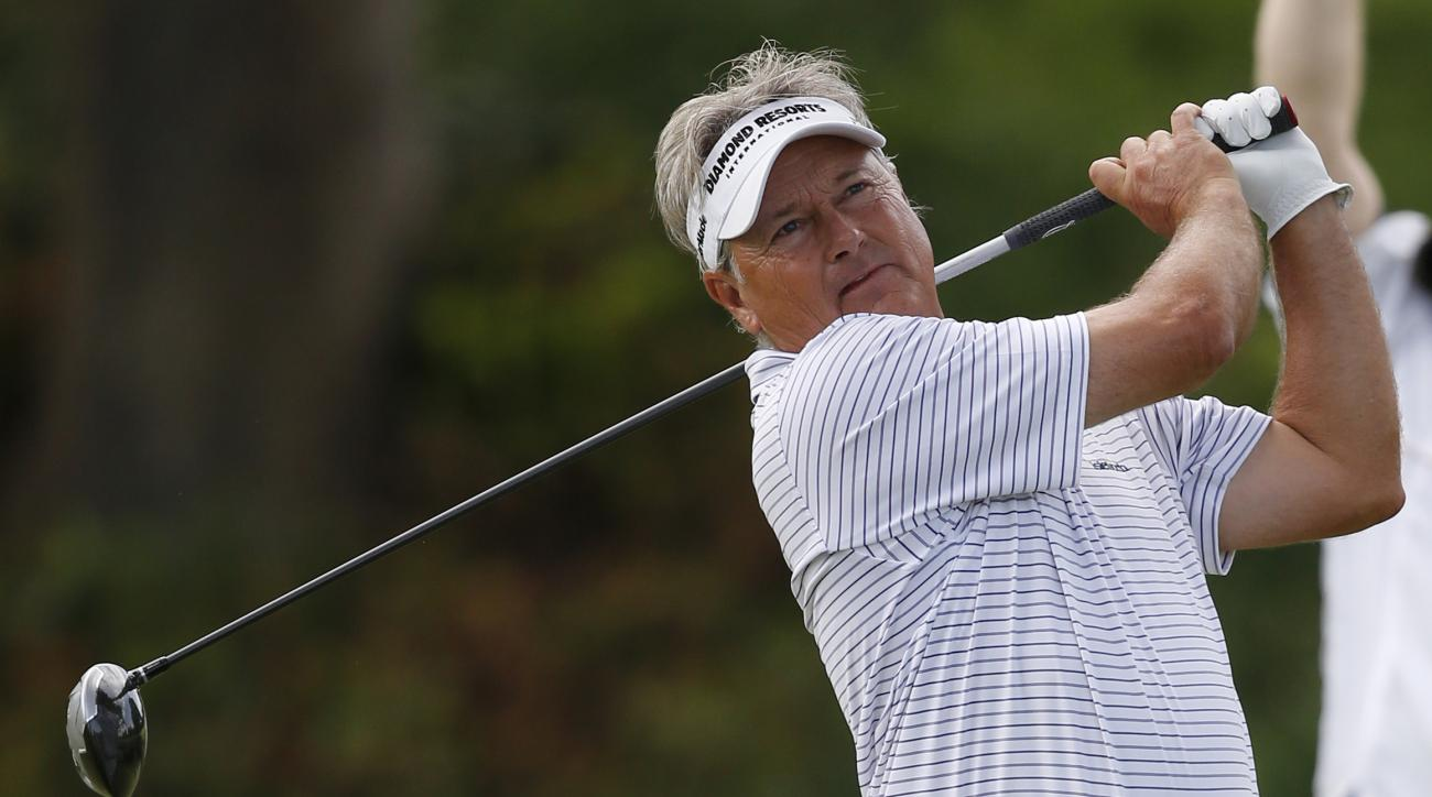 John Cook hits from the 14th tee in the first round of play at the 2014 U.S. Senior Open golf tournament at Oak Tree National in Edmond, Okla., Thursday, July 10, 2014. (AP Photo/Sue Ogrocki)
