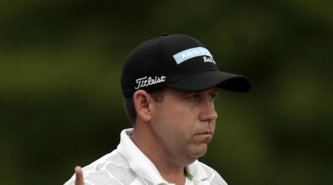 Erik Compton reacts after making a birdie putt on the first hole during the third round of the Zurich Classic PGA golf tournament, Saturday, April 25, 2015, in Avondale, La. (AP Photo/Butch Dill)