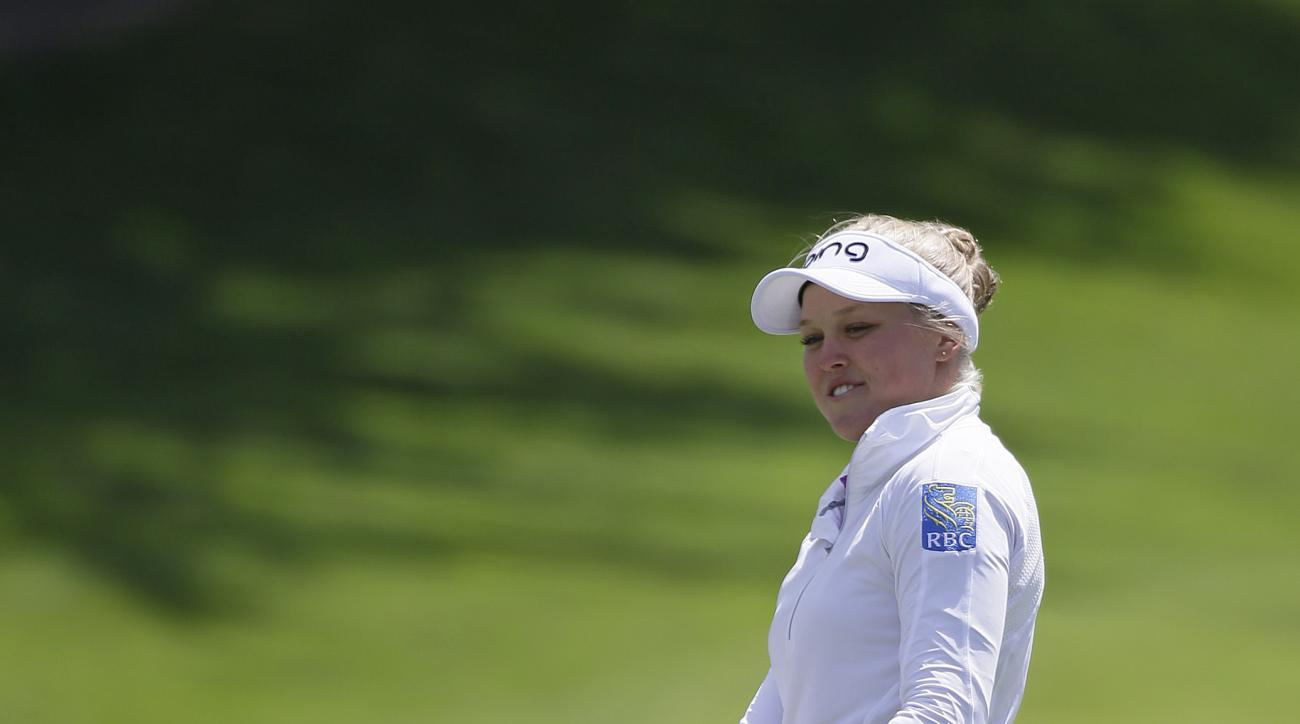 Brooke Henderson of Canada gestures after putting on the second green of the Lake Merced Golf Club during the third round of the Swinging Skirts LPGA Classic golf tournament Saturday, April 25, 2015, in Daly City, Calif. (AP Photo/Eric Risberg)