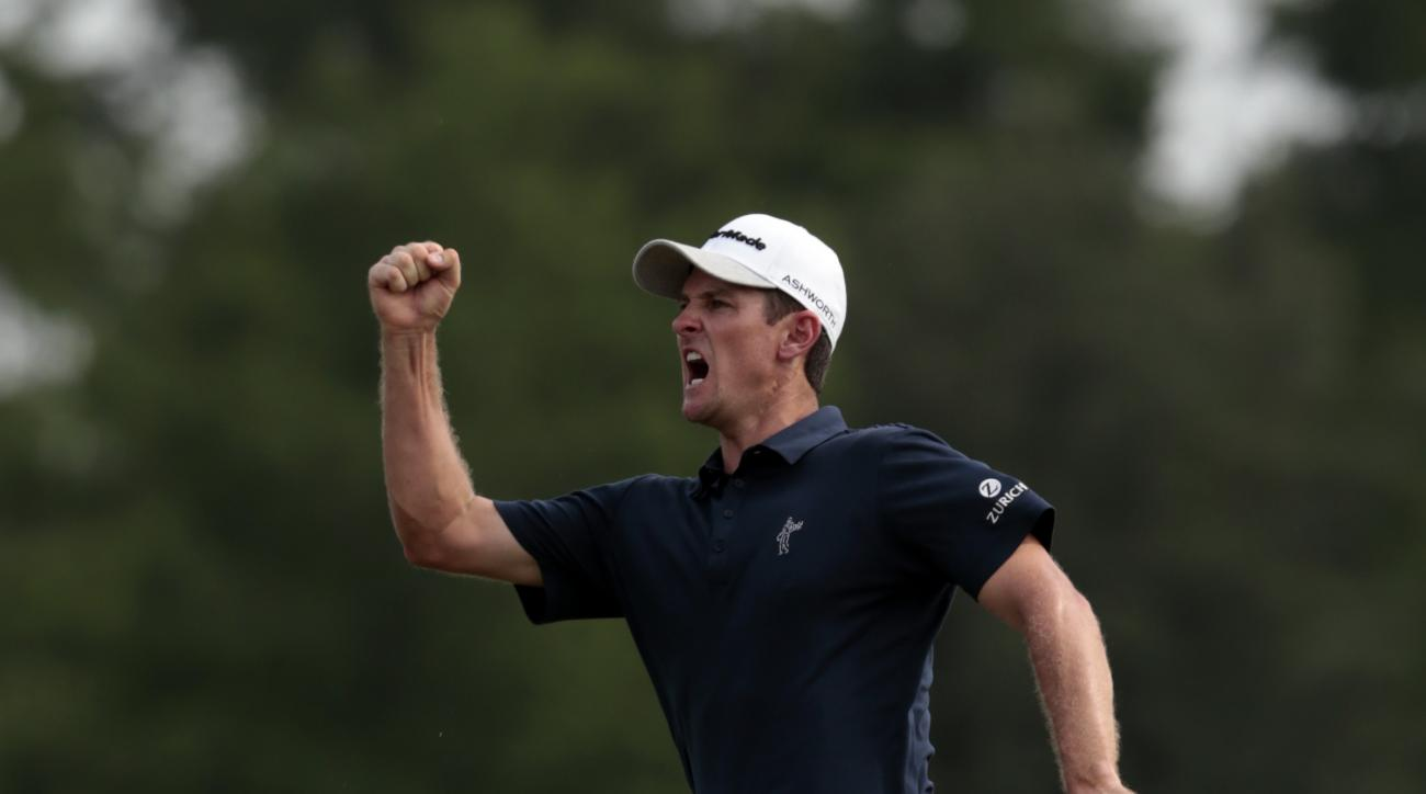 Justin Rose, of England, celebrates after making a birdie putt on the 18th hole during the final round of the Zurich Classic PGA golf tournament, Sunday, April 26, 2015, in Avondale, La. (AP Photo/Butch Dill)