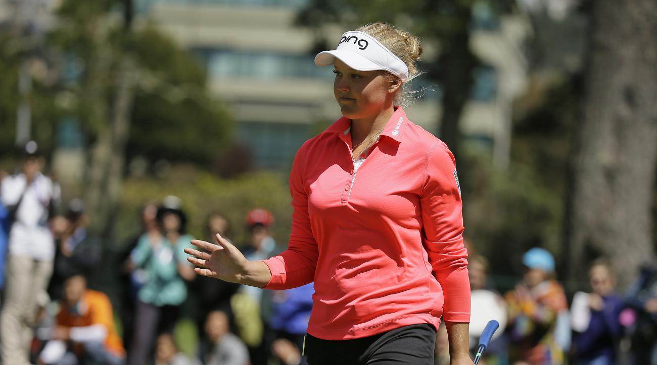 Brooke Henderson, of Canada, waves after making a birdie putt on the sixth green of the Lake Merced Golf Club during the final round of the Swinging Skirts LPGA Classic golf tournament Sunday, April 26, 2015, in Daly City, Calif. (AP Photo/Eric Risberg)