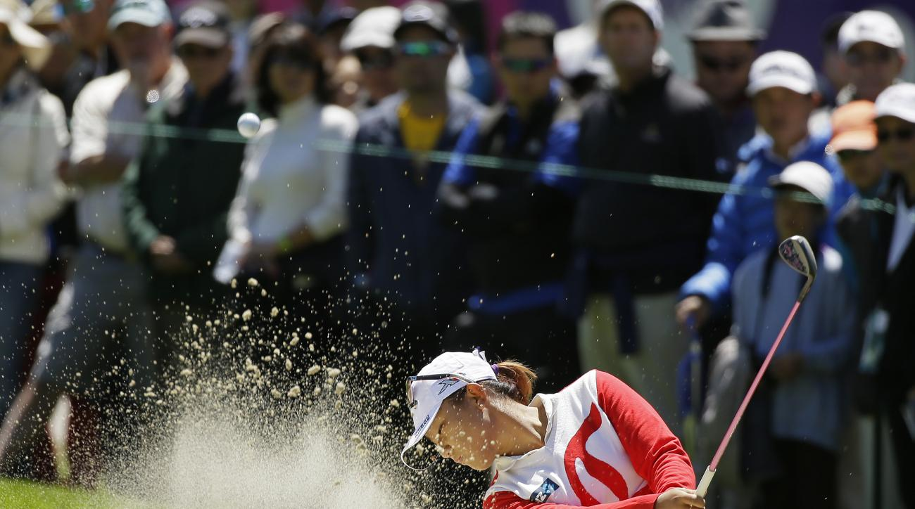 Lydia Ko, of New Zealand, hits the ball out of a bunker up to the first green of the Lake Merced Golf Club during the final round of the Swinging Skirts LPGA Classic golf tournament Sunday, April 26, 2015, in Daly City, Calif. (AP Photo/Eric Risberg)