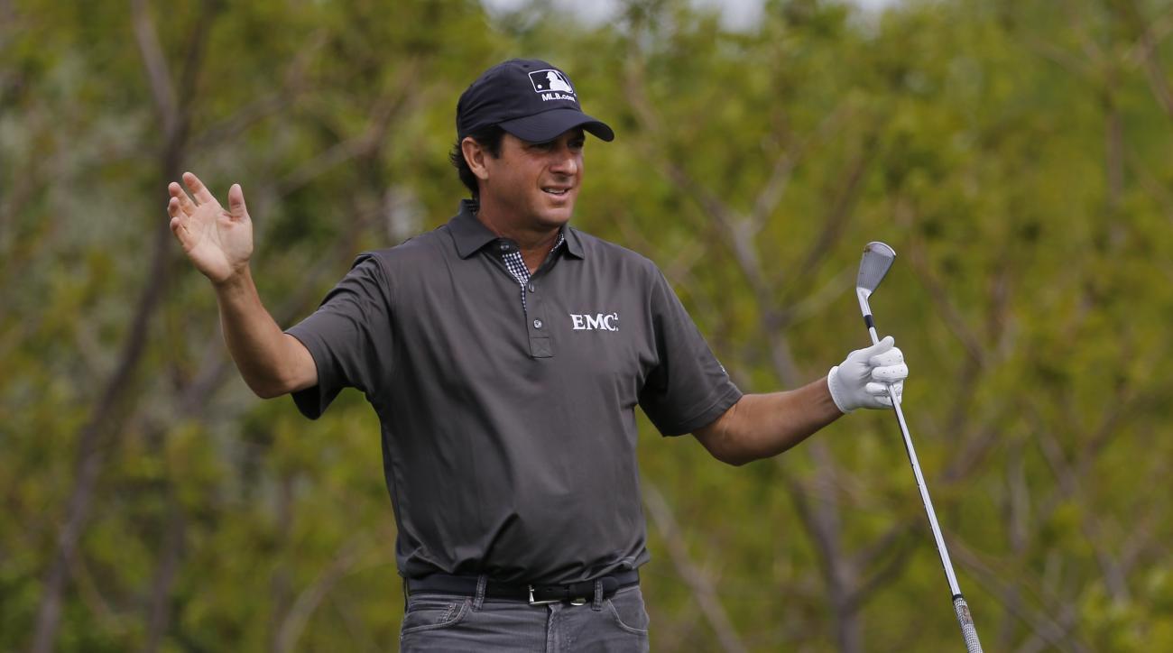 Billy Andrade reacts to his tee shot on the 4th hole during the first round of the 75th Senior PGA Championship golf tournament at the Harbor Shores Golf Club in Benton Harbor, Mich., Thursday, May 22, 2014.  (AP Photo/Paul Sancya)