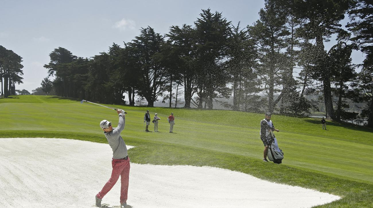 Justin Rose, of England, hits out of a bunker onto the 10th green of TPC Harding Park during round-robin play against Marc Leishman, of Australia, at the Match Play Championship golf tournament Wednesday, April 29, 2015, in San Francisco. (AP Photo/Ben Ma