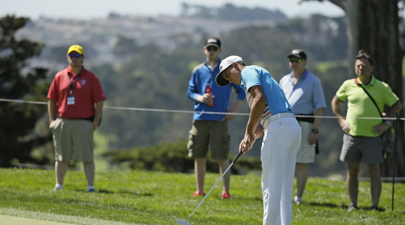 Rickie Fowler putts on the fourth green of TPC Harding Park during round-robin play against Shane Lowry of Ireland at the Match Play Championship golf tournament Thursday, April 30, 2015, in San Francisco. (AP Photo/Eric Risberg)