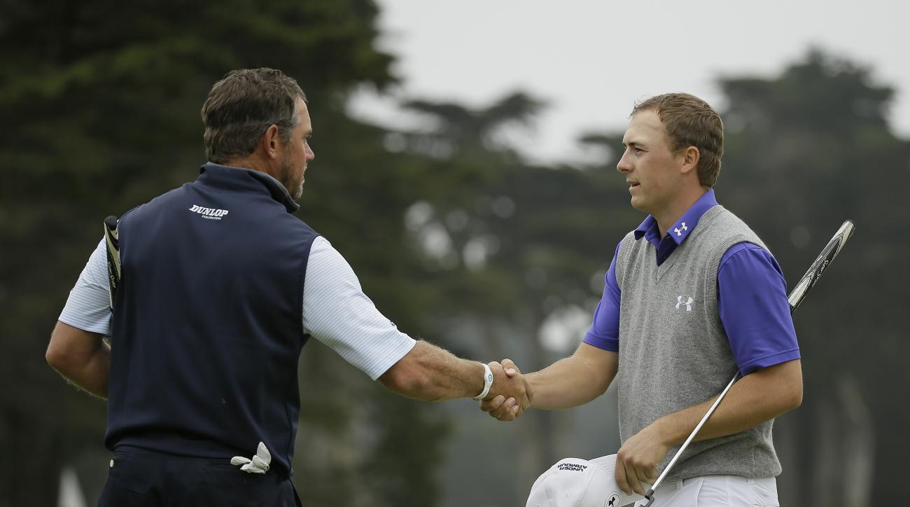 Lee Westwood, left, of England, is greeted by Jordan Spieth, right, on the 18th green of TPC Harding Park at the end of their round-robin play at the Match Play Championship golf tournament Friday, May 1, 2015, in San Francisco. Westwood won the match 2 u