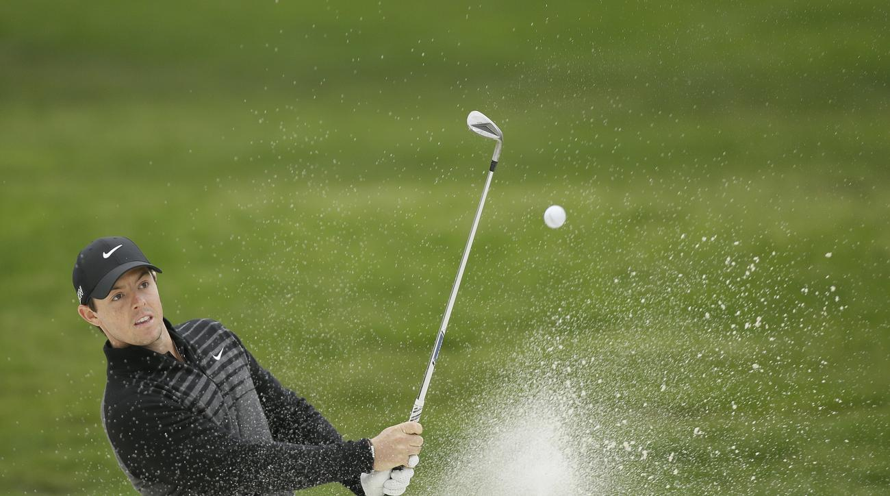Rory McIlroy of Northern Ireland hits out of a bunker up to the 15th green of TPC Harding Park during round-robin play against Billy Horschel at the Match Play Championship golf tournament Friday, May 1, 2015, in San Francisco. McIlroy won the match on th