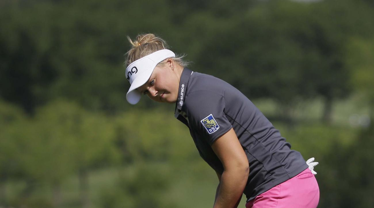 Brooke Henderson watches her putt begin to fall in the hole on the second green during the third round of the LPGA North Texas Shootout golf tournament, Saturday, May 2, 2015, in Irving, Texas. (AP Photo/LM Otero)