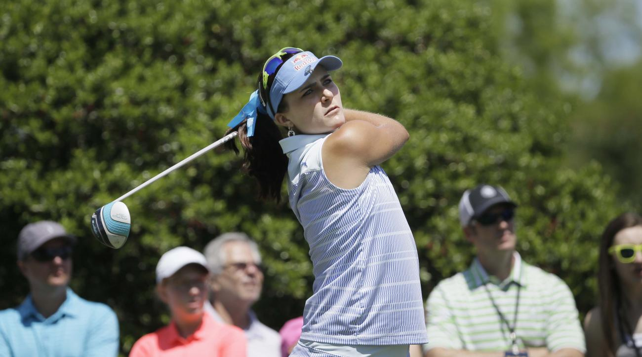 Lexi Thompson watches her tee shot on the second hole during the final round of the LPGA North Texas Shootout golf tournament, Sunday, May 3, 2015, in Irving, Texas. (AP Photo/LM Otero)
