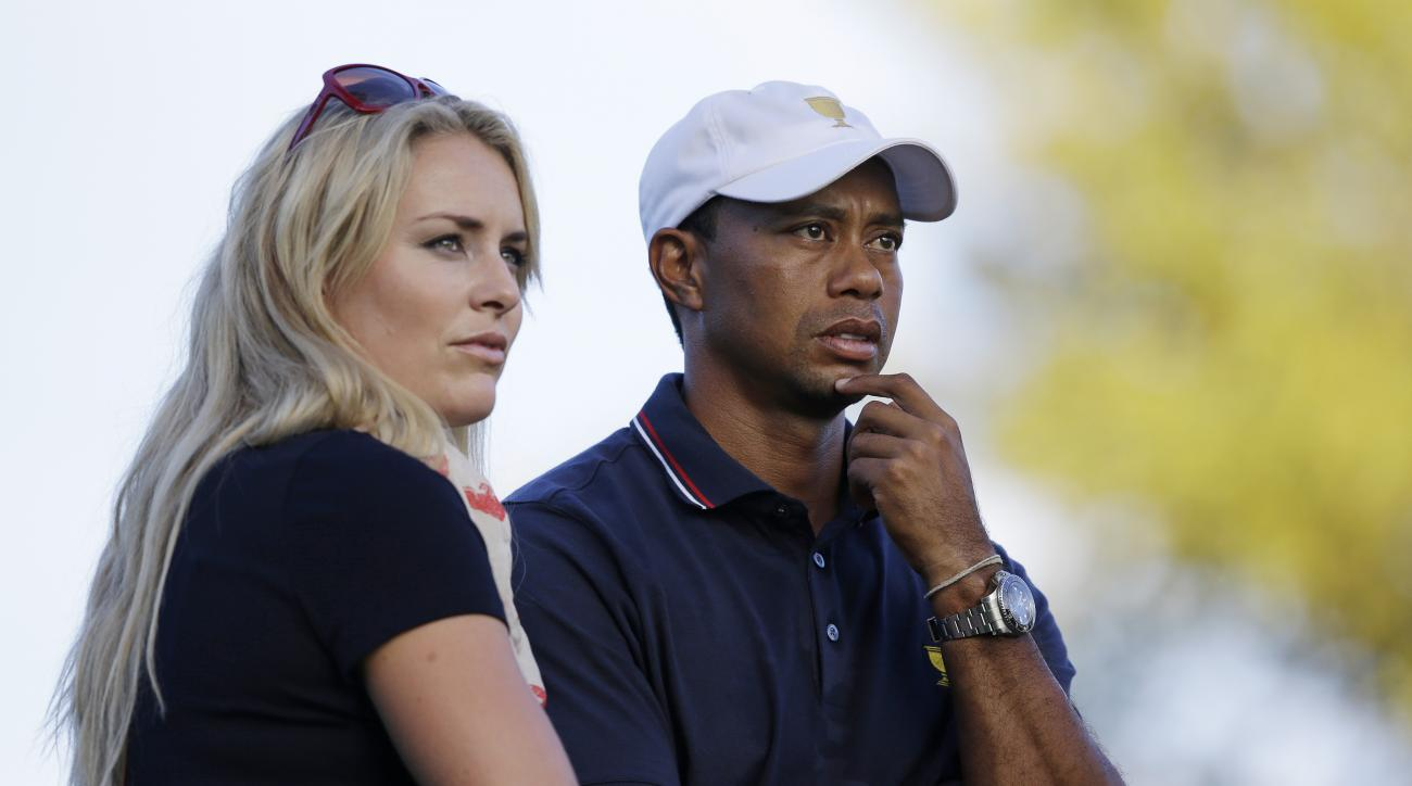 FILE - This Oct. 3, 2013 file photo shows Tiger Woods watching with his girlfriend Lindsey Vonn at the Presidents Cup golf tournament at Muirfield Village Golf Club in Dublin, Ohio. Vonn announced on Sunday, May 3, 2015, that she and Woods have decided to