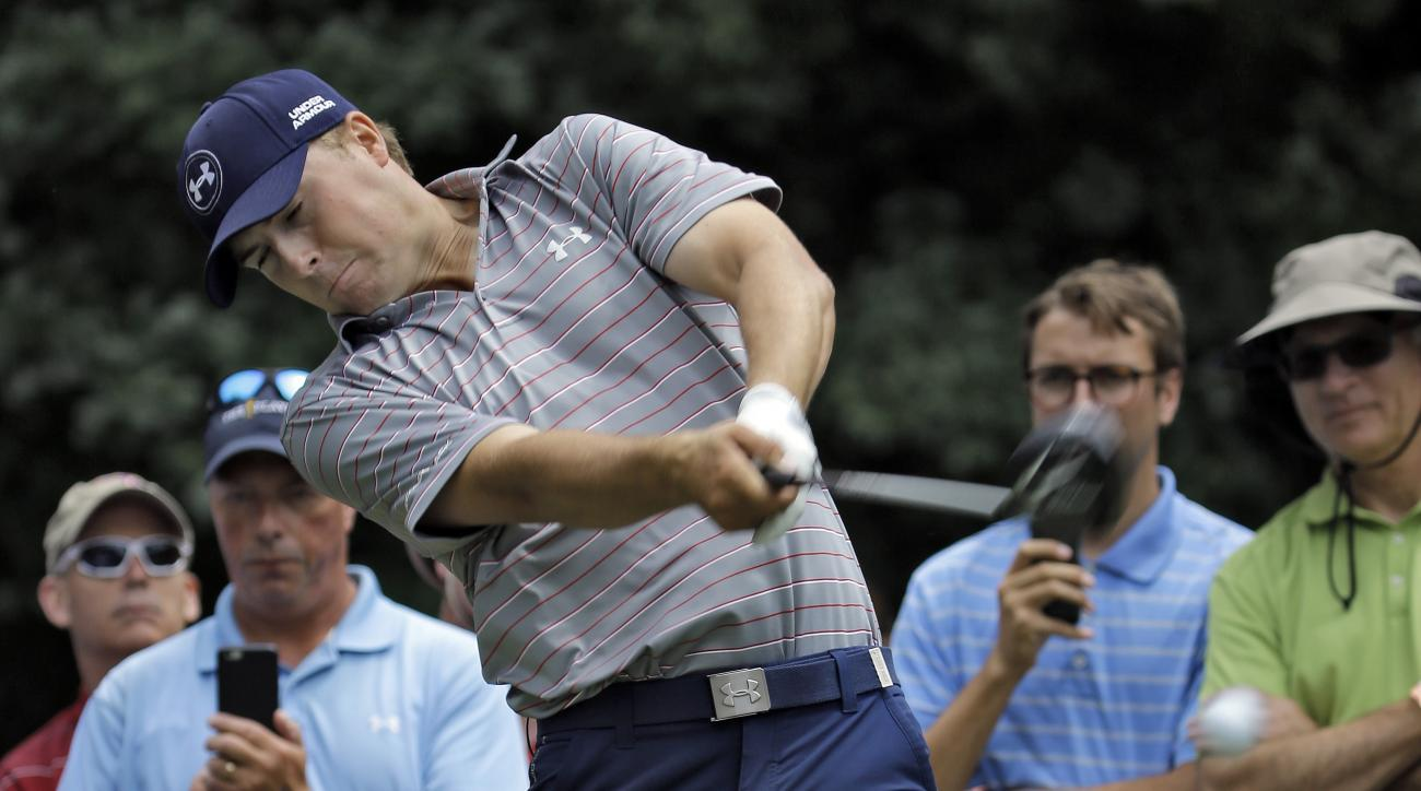 Jordan Spieth hits his tee shot on the 15th hole during a practice round at The Players Championship golf tournament Wednesday, May 6, 2015, in Ponte Vedra Beach, Fla. (AP Photo/Chris O'Meara)