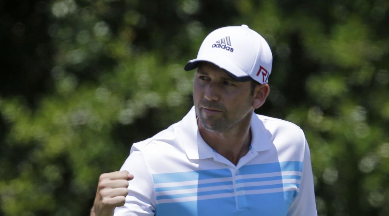 Sergio Garcia, of Spain, pumps his fist after making an eagle shot on the second hole during the third round of The Players Championship golf tournament Saturday, May 9, 2015, in Ponte Vedra Beach, Fla. (AP Photo/Chris O'Meara)