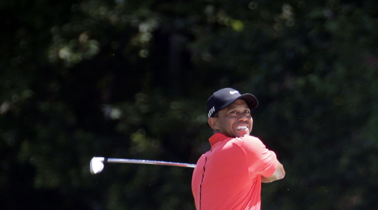 Tiger Woods watches his shot from the 14 fairway during the final round of The Players Championship golf tournament Sunday, May 10, 2015, in Ponte Vedra Beach, Fla. (AP Photo/Lynne Sladky)