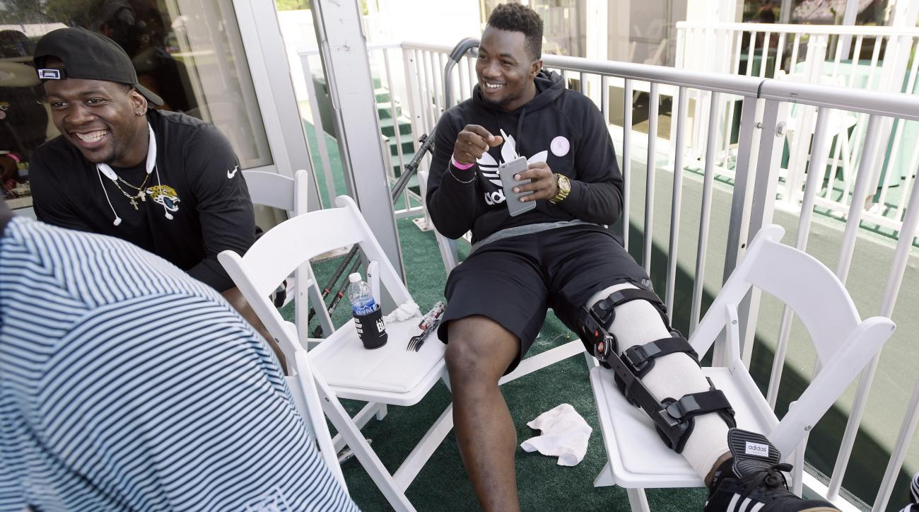 Jacksonville Jaguars first draft pick Dante Fowler Jr. sits with other team rookies in a tent overlooking the 17 green during the final round of The Players Championship golf tournament Sunday, May 10, 2015, in Ponte Vedra Beach, Fla. Fowler was hurt duri
