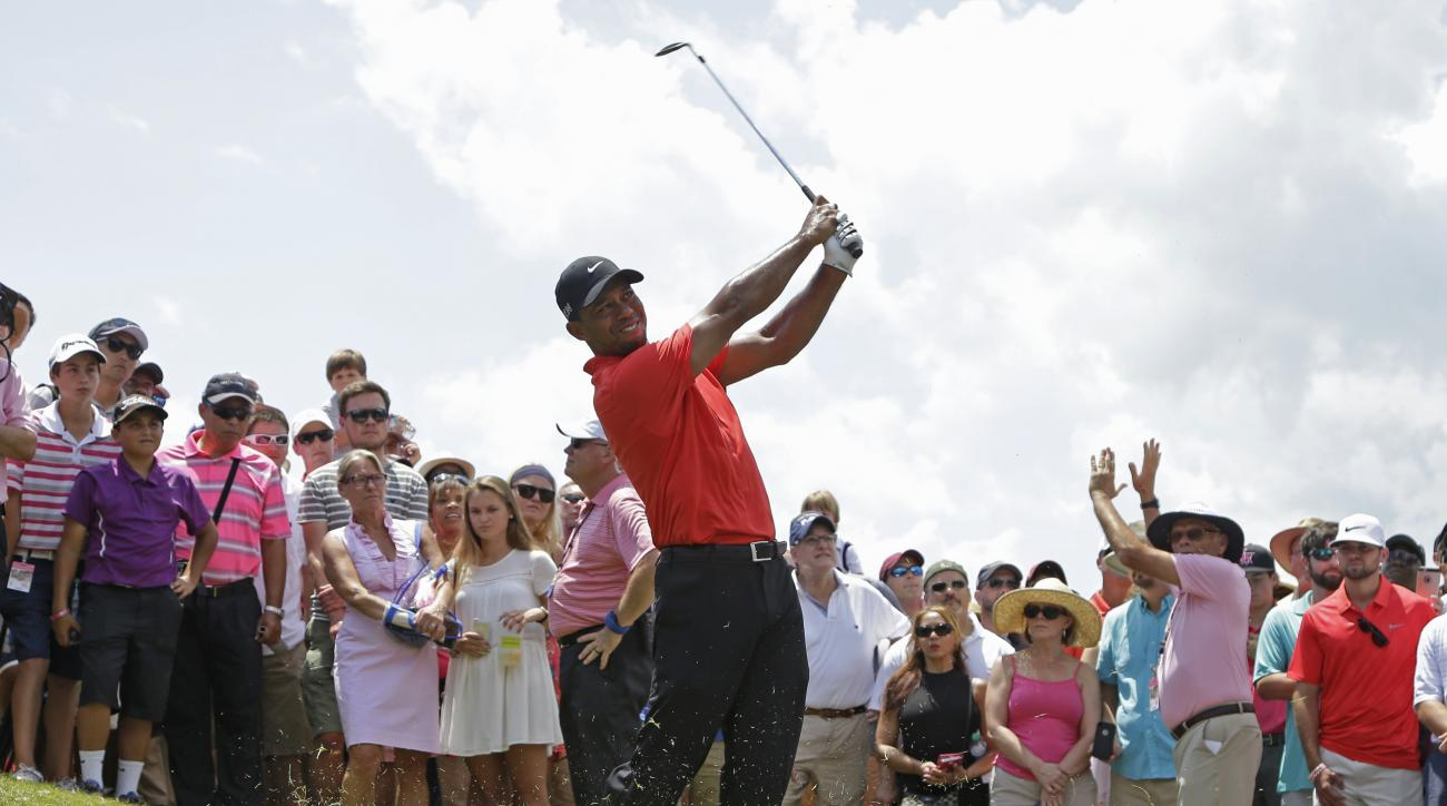 Tiger Woods hits from the rough off the 18th fairway during the final round of The Players Championship golf tournament, Sunday, May 10, 2015, in Ponte Vedra Beach, Fla. (AP Photo/Lynne Sladky)
