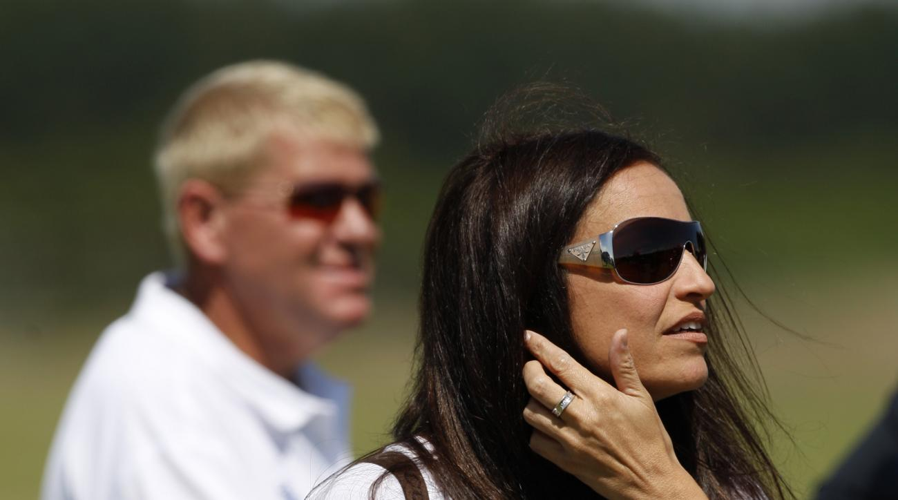 Anna Cladakis, the girlfriend of John Daly of the US, background left, is seen during practice for the British Open Golf championship, at the Turnberry golf course, Scotland, Wednesday, July 15, 2009. (AP Photo/Jon Super)