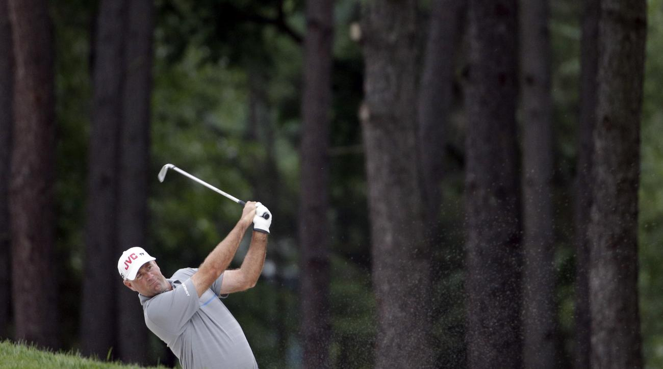 Stewart Cink watches his shot from a sand trap on the 10th fairway during the second round of the Wells Fargo Championship golf tournament at Quail Hollow Club in Charlotte, N.C., Friday, May 15, 2015. (AP Photo/Chuck Burton)