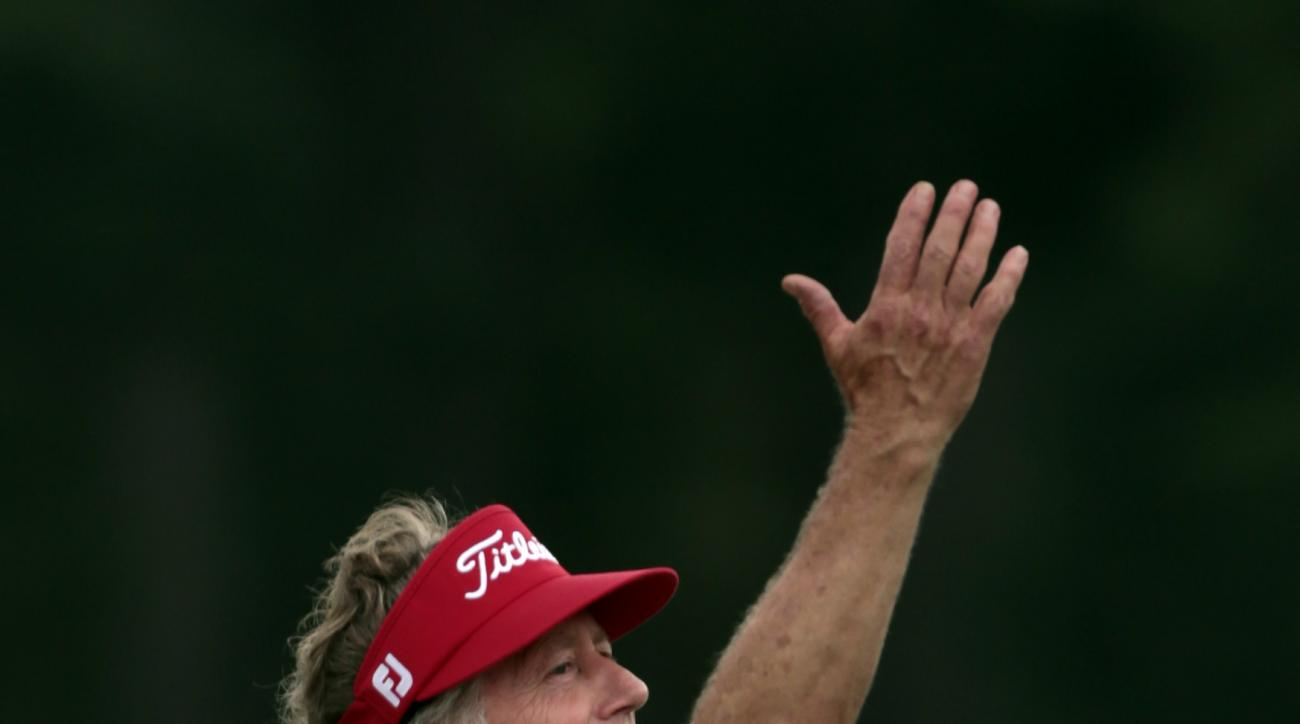 Michael Allen celebrates after making a birdie putt on the 18th hole during the Regions Tradition Champions Tour golf tournament at Shoal Creek Country Club, Friday, May 15, 2015, in Birmingham, Ala. (AP Photo/Butch Dill)