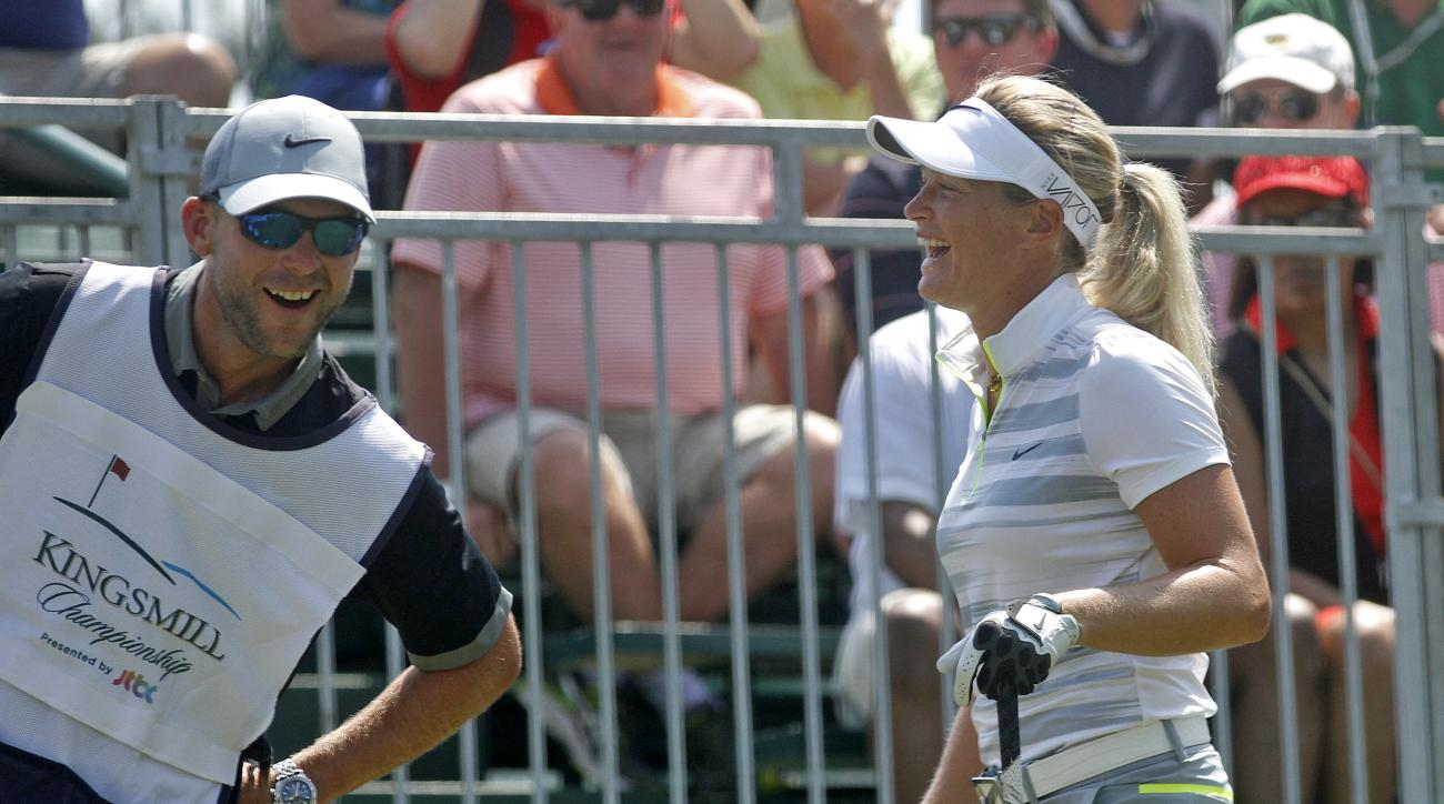 Suzann Pettersen, right, laughs with her caddie before the third round of the LPGA Tour's Kingsmill Championship golf tournament on Saturday, May 16, 2015, in Williamsburg, Va. (Jonathan Gruenke/The Daily Press via AP)
