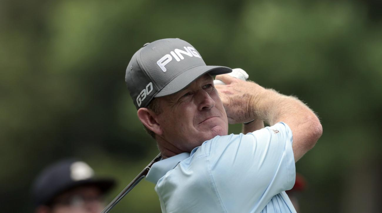 Jeff Maggert watches his tee shot on the seventh hole during the final round of the Regions Tradition Champions Tour golf tournament at Shoal Creek Country Club, Sunday, May 17, 2015, in Birmingham, Ala. (AP Photo/Butch Dill)