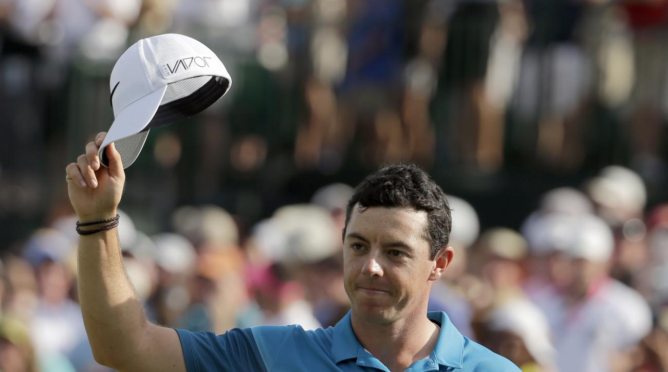 Rory McIlroy, of Northern Ireland, celebrates after winning the Wells Fargo Championship golf tournament at Quail Hollow Club in Charlotte, N.C., Sunday, May 17, 2015. (AP Photo/Chuck Burton)