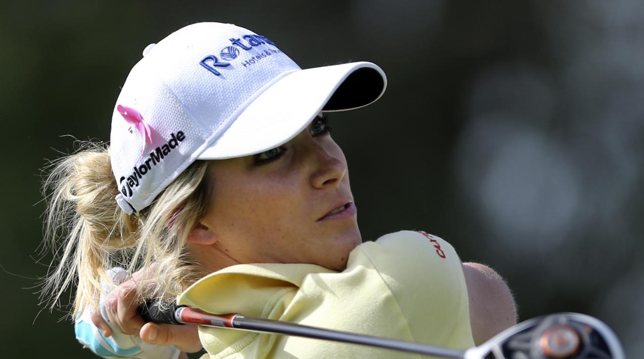 Melissa Reid of England tees off on the 1st hole during the final round of the Omega Dubai Ladies Masters in Dubai, United Arab Emirates, Saturday, Dec. 13, 2014. (AP Photo/Kamran Jebreili)