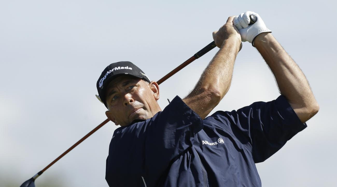 Tom Lehman of the United States plays his tee shot from the fourth tee during a practice round at Royal Lytham & St Annes golf club ahead of the British Open Golf Championship, Lytham St Annes, England, Wednesday, July 18, 2012. (AP Photo/Jon Super)
