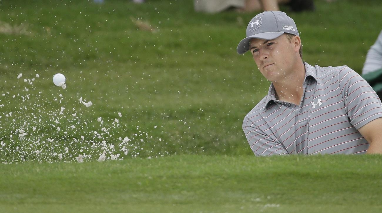 Jordan Spieth hits from a bunker on the 12th hole during the third round of the Colonial golf tournament Saturday, May 23, 2015, in Fort Worth, Texas. (AP Photo/LM Otero)