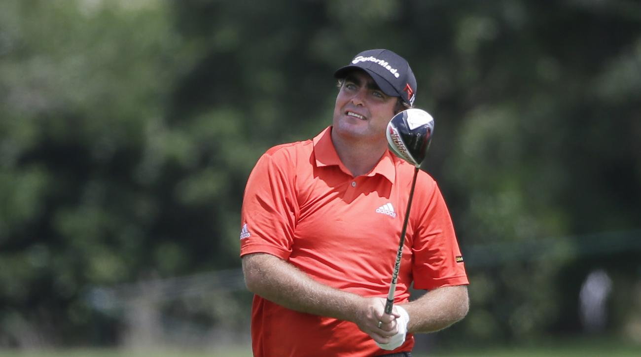 Steven Bowditch watches an approach shot on the 17th fairway during the first round of the Byron Nelson golf tournament, Thursday, May 28, 2015, in Irving, Texas. (AP Photo/LM Otero)