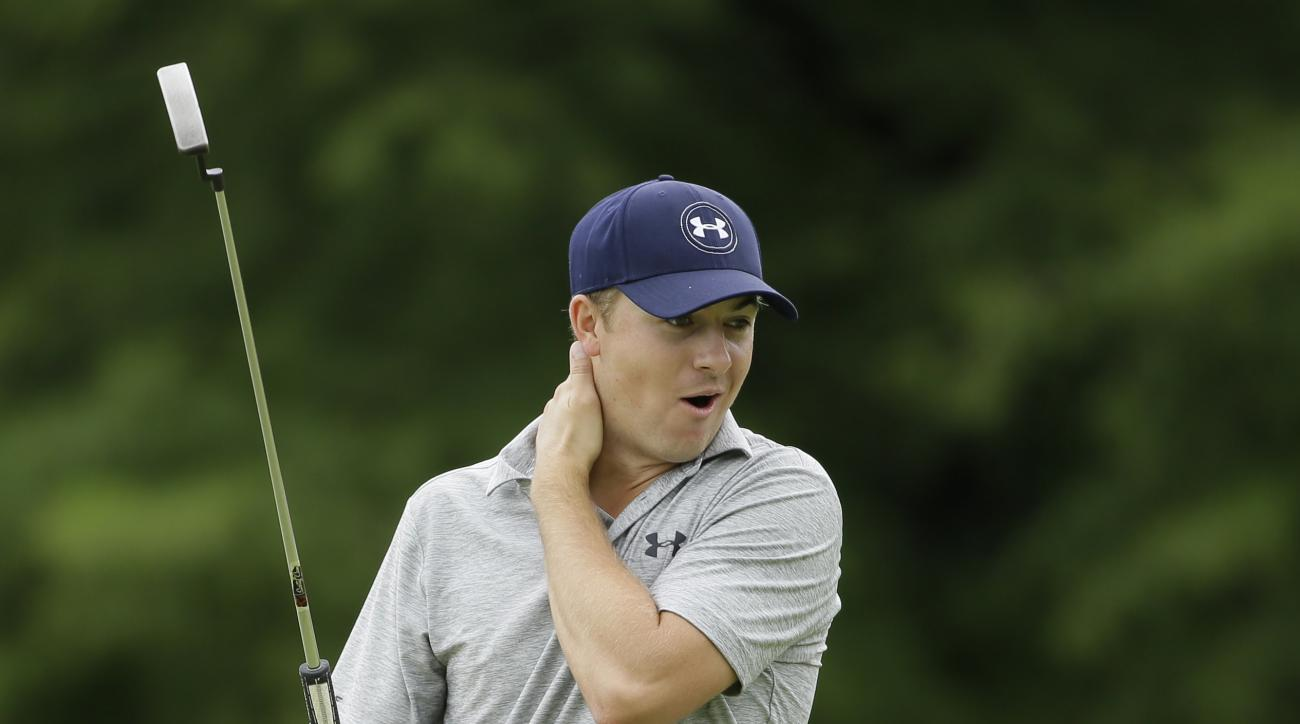 Jordan Spieth reacts to watching his playing partner Brooks Koepka, not shown, just miss as putt on the 14th green during the second round of the Byron Nelson golf tournament, Friday, May 29, 2015, in Irving, Texas. (AP Photo/LM Otero)