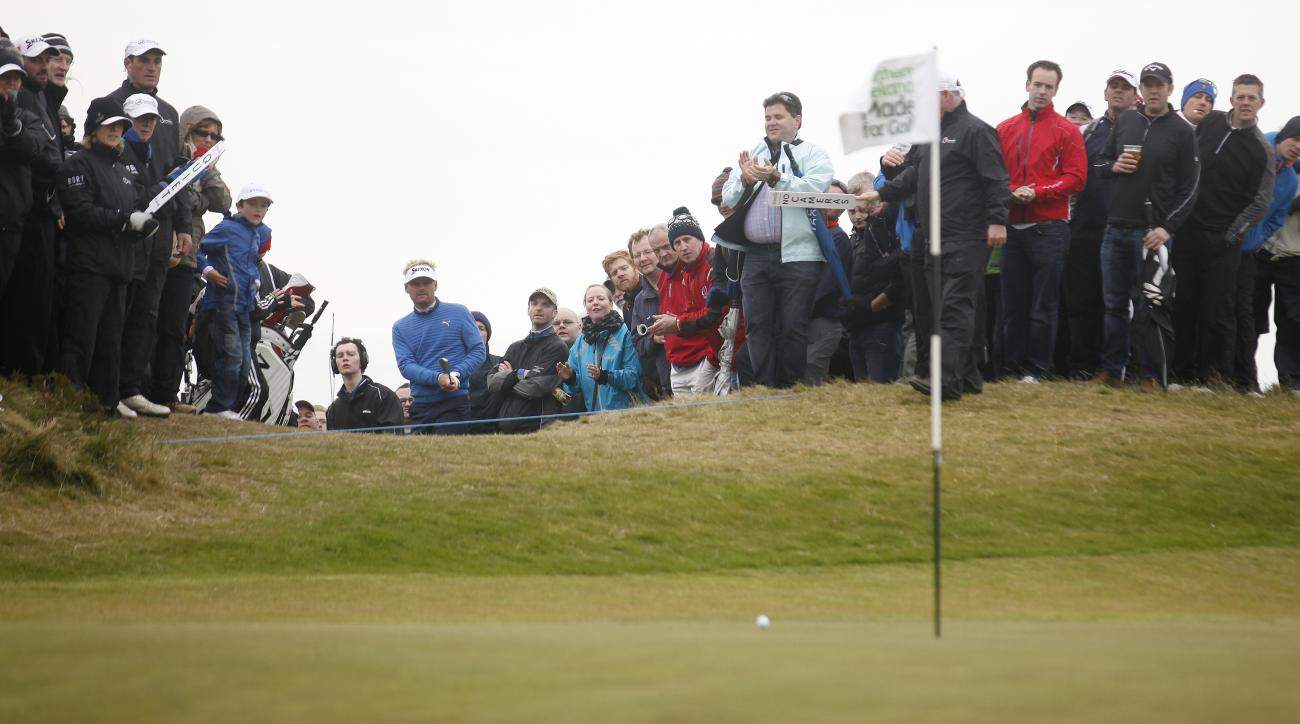 Denmark's Soren Kjeldsen plays a wedge shot on the 7th hole during round three of the Irish Open Golf Championship at Royal County Down, Newcastle, Northern Ireland, Saturday, May 30, 2015.  (AP Photo/Peter Morrison)