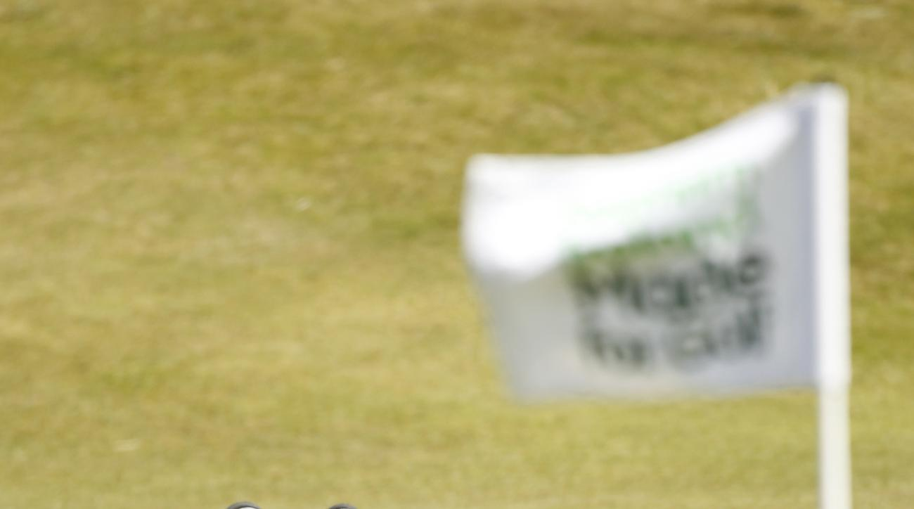 Germany's Maximilian Kieffer lines up a putt on the fourth hole during the final round of the Irish Open Golf Championship at Royal County Down, Newcastle, Northern Ireland, Sunday, May 31, 2015. (AP Photo/Peter Morrison)