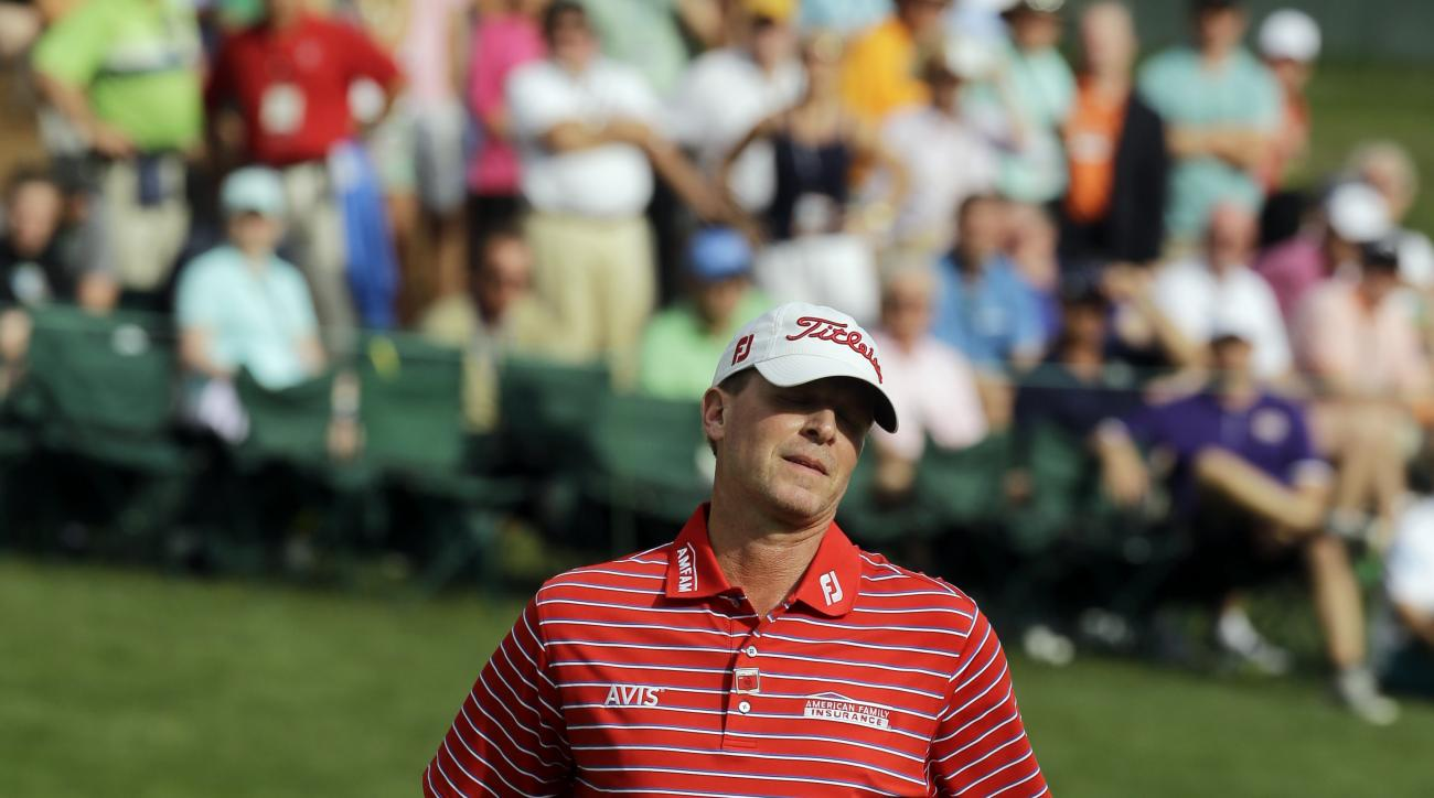 FILE - In this April 10, 2015, file photo, Steve Stricker reacts after a missed putt on the 16th hole during the second round of the Masters golf tournament in Augusta, Ga. The last time Stricker had to qualify for a U.S. Open he was trying rejuvenate his