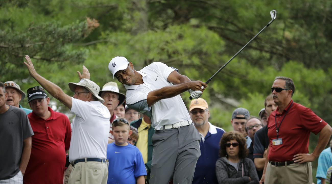 Tiger Woods hits on the 13th hole during the first round of the Memorial golf tournament  Thursday, June 4, 2015, in Dublin, Ohio. (AP Photo/Darron Cummings)