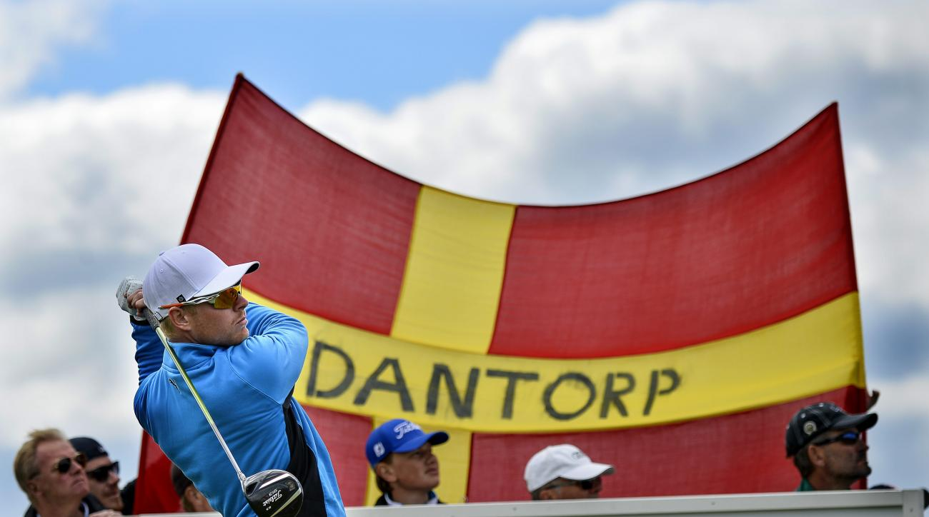 Sweden's Jens Dantorp watches the flight of his ball in front of a flag with his name on it, during the first day of the Nordea Masters at the PGA of Sweden National golf club outside Malmo, Sweden, Thursday May 29, 2014. (AP Photo / Anders Wiklund, TT)