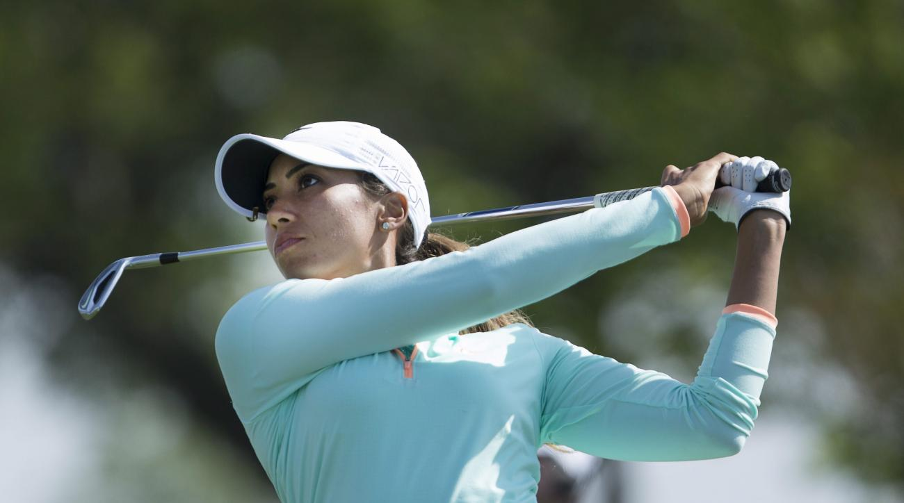 Cheyenne Woods watches her tee shot from the 13th tee during the first round of the Manulife LPGA Classic golf tournament, Thursday, June 4, 2015, in Cambridge, Ontario. (Peter Power/The Canadian Press via AP)