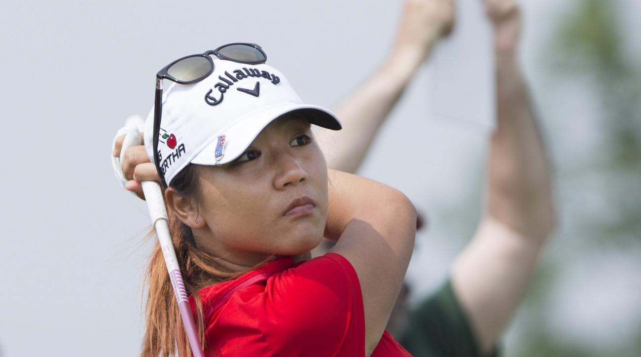 Lydia Ko, of New Zealand, watches her shot off the first tee  during the second round of the Manulife LPGA Classic golf tournament, Friday, June 5, 2015, in Cambridge, Ontario. (Peter Power/The Canadian Press via AP) MANDATORY CREDIT