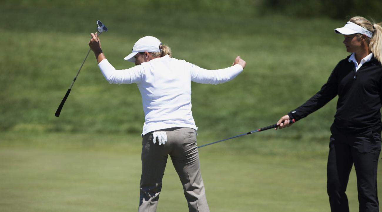 Suzann Pettersen, of Norway, stops Cristie Kerr, of the United States, from stepping on the putting line of Mariajo Uribe at the second hole during the third round of the 2015 Manulife LPGA Classic, Saturday, June 6, 2015 in Cambridge, Ontario. (Peter Pow