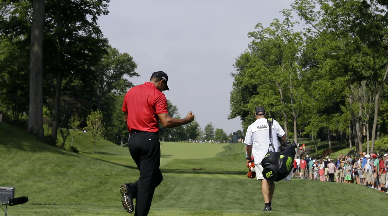 Tiger Woods reacts to his drive on the 15th hole during the final round of the Memorial golf tournament Sunday, June 7, 2015, in Dublin, Ohio. (AP Photo/Darron Cummings)