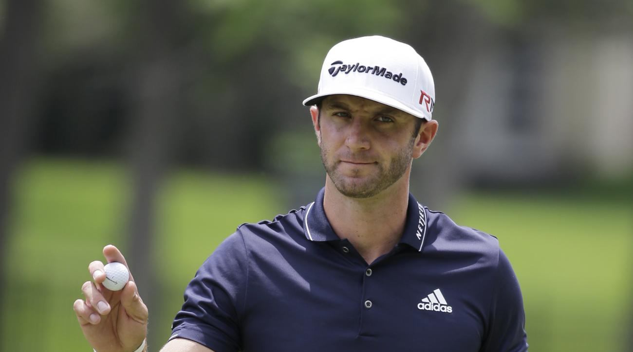 Dustin Johnson reacts after making a birdie on the second hold during the final round of the Memorial golf tournament Sunday, June 7, 2015, in Dublin, Ohio. (AP Photo/Darron Cummings)