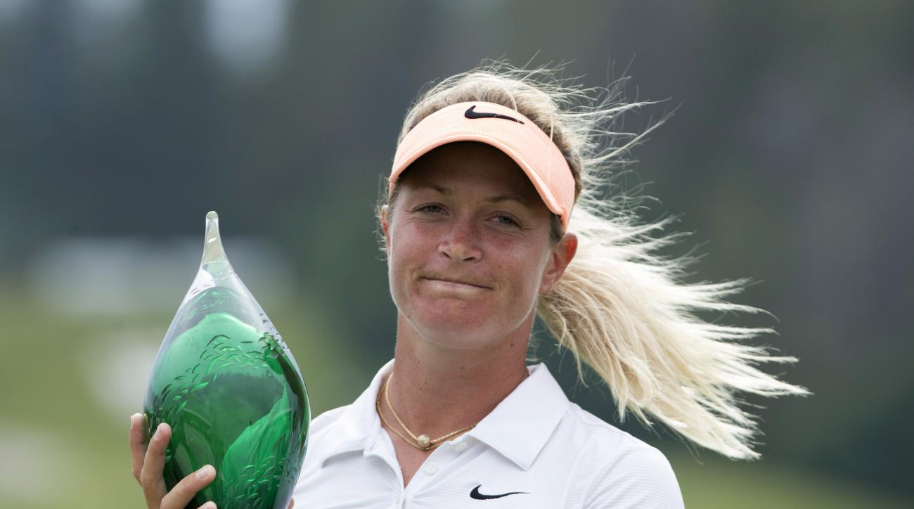 Suzann Pettersen, of Norway, holds the winner's trophy at the 2015 Manulife LPGA Classic in Cambridge, Ontario, on Sunday, June 7, 2015. Pettersen finished with a score of -22, one shot better than American Brittany Lang who hit seven under to finish at -