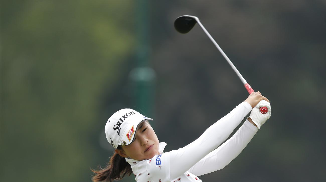 Sakura Yokomine, of Japan, tees off on the 10th hole during the KPMG Women's PGA golf championship at Westchester Country Club, Thursday, June 11, 2015, in Harrison, N.Y. (AP Photo/Julio Cortez)