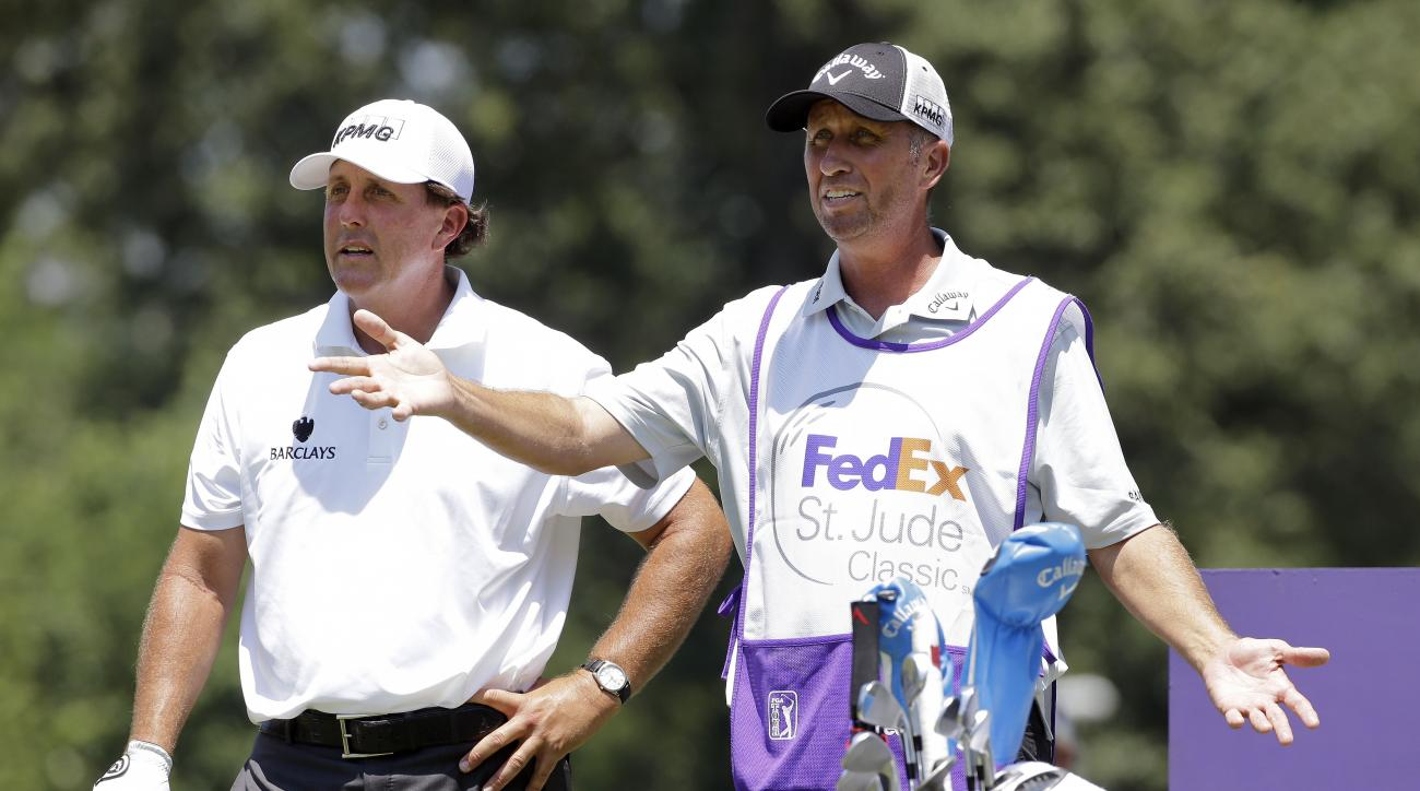 Phil Mickelson,.left, talks with his caddie Jim Mackay on the eighth tee during the first round of the St. Jude Classic golf tournament Thursday, June 11, 2015, in Memphis, Tenn. Mickelson bogeyed the hole. (AP Photo/Mark Humphrey)