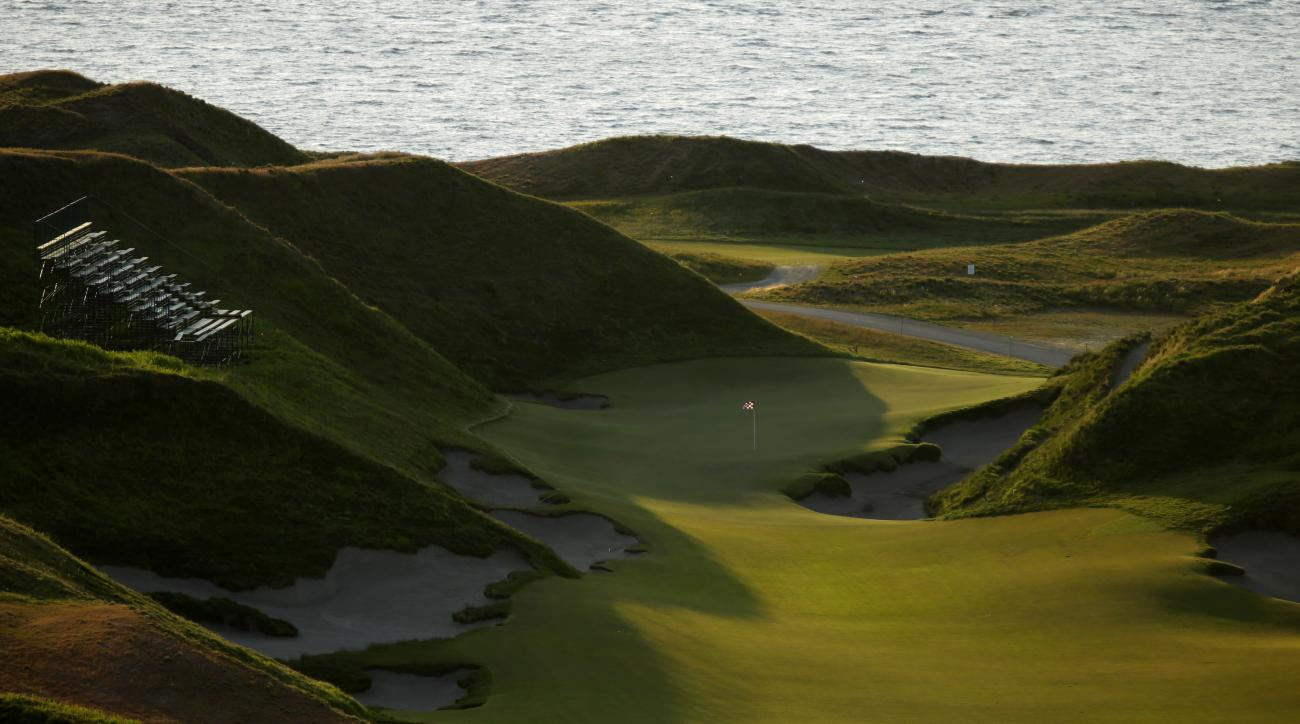 In this April 29, 2015, photo, the 10th hole of the Chambers Bay golf course is shown at sunset in University Place, Wash. Next week the course, which opened in 2007, will become the youngest golf course to host the U.S. Open since Hazeltine in 1970. (AP