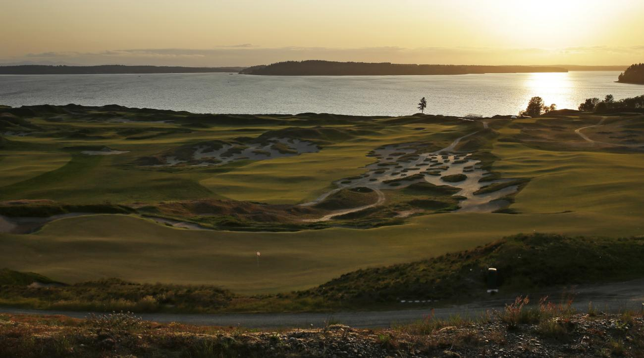 In this April 29, 2015, photo, Chambers Bay golf course is shown at sunset in University Place, Wash. Chambers Bay will host the 115th U.S. Open golf tournament next week, but the course is a mystery to the majority of the players because it opened only e