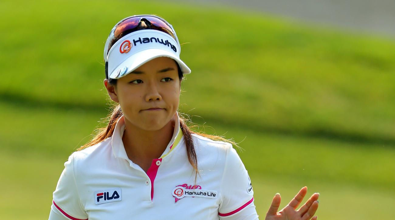 Jenny Shin, of South Korea, acknowledges the crowd after putting on the 11th green during the second round of the KPMG Women's PGA golf championship at Westchester Country Club, Friday, June 12, 2015, in Harrison, N.Y.  (AP Photo/Adam Hunger)