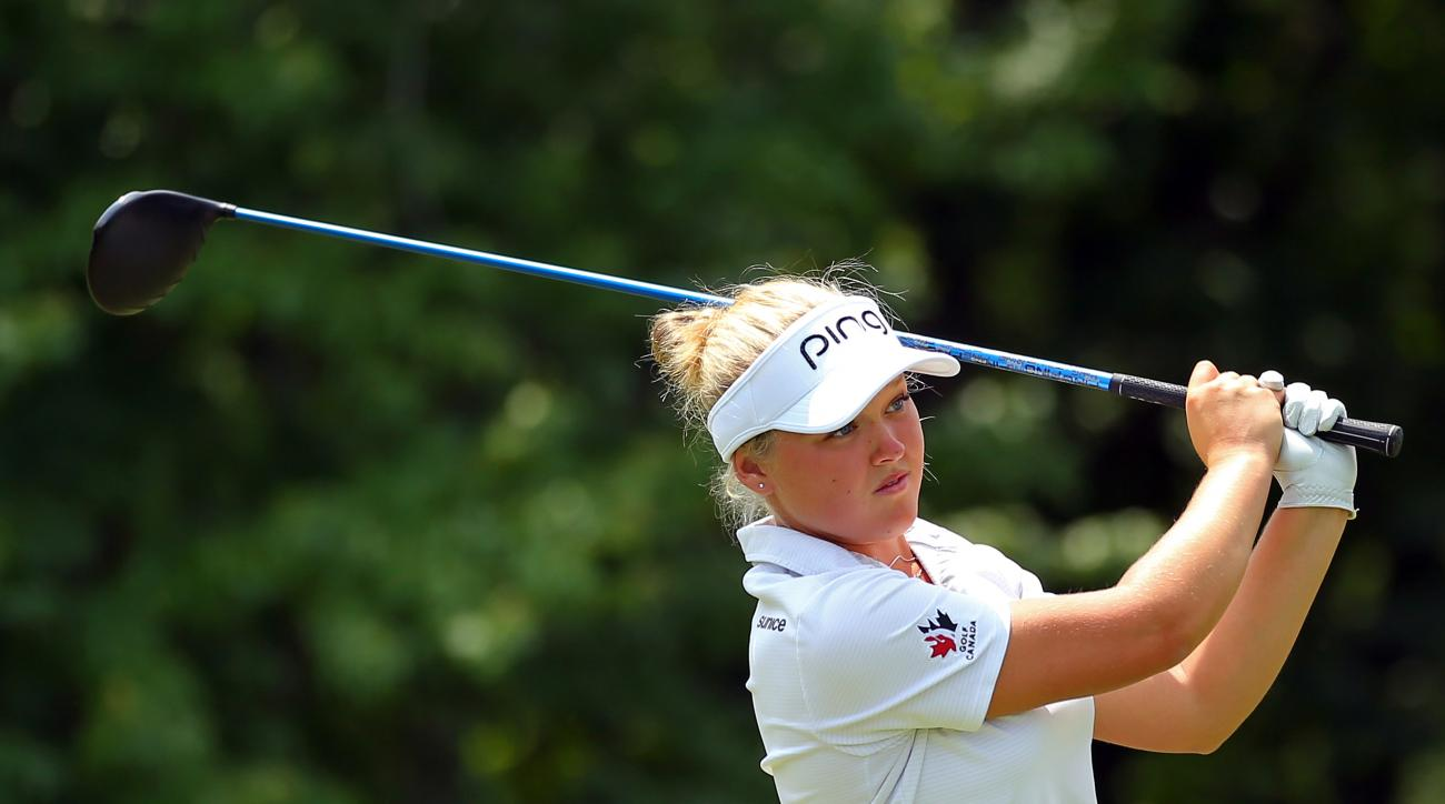 Brooke Henderson, of Canada, watches her tee shot on the 13th hole during the second round of the KPMG Women's PGA golf championship at Westchester Country Club, Friday, June 12, 2015, in Harrison, N.Y.  (AP Photo/Adam Hunger)