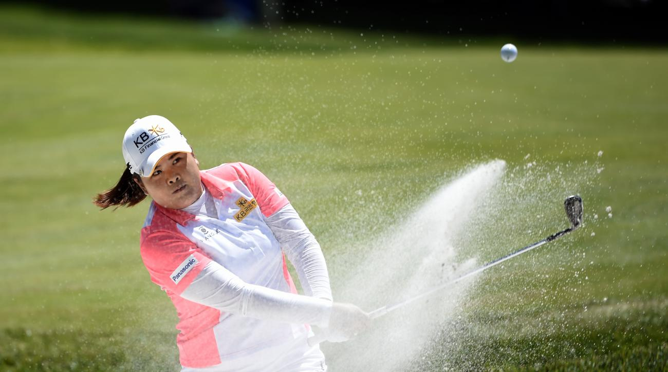 Inbee Park, of South Korea, hits out of a sand trap on the first green during the third round of the KPMG Women's PGA golf championship at Westchester Country Club on Saturday, June 13, 2015, in Harrison, N.Y. (AP Photo/Kathy Kmonicek)