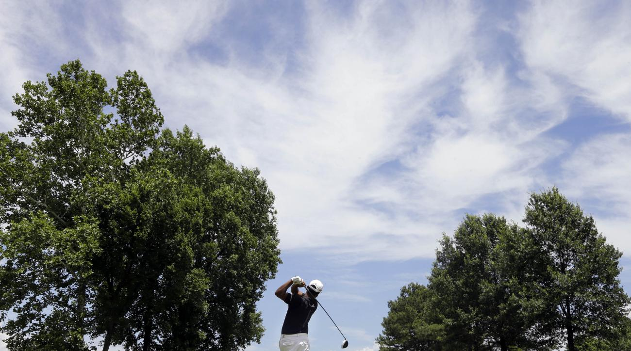 Fabian Gomez, of Argentina, drives on the seventh tee during the final round of the St. Jude Classic golf tournament Sunday, June 14, 2015, in Memphis, Tenn. (AP Photo/Mark Humphrey)