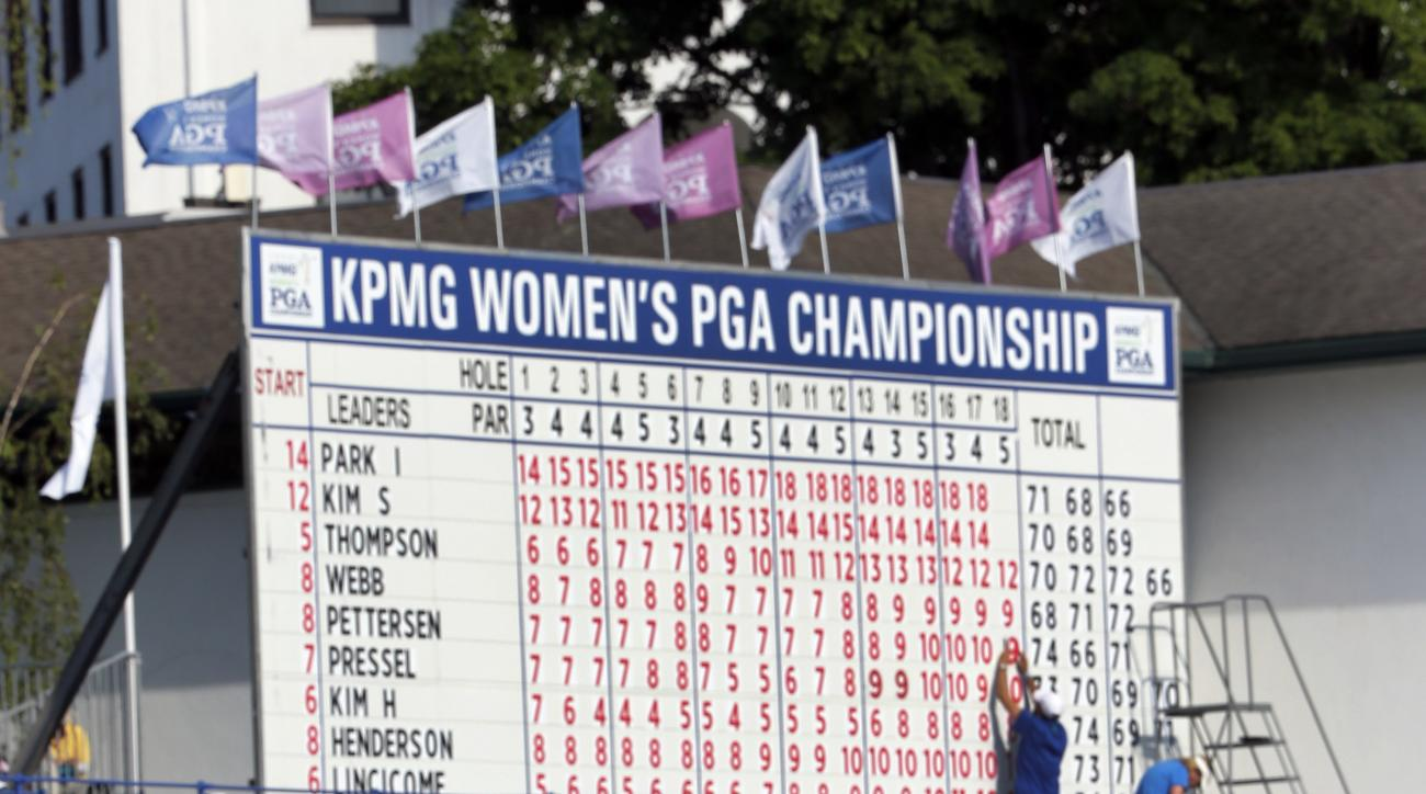 Inbee Park, of South Korea, hits to the 18th green during the final round of the KPMG Women's PGA golf championship at Westchester Country Club in Harrison, N.Y., Sunday, June 14, 2015. (AP Photo/Julio Cortez)